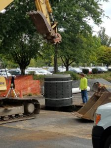 Drywells are 10-20 ft vertical cement pipes with holes that are filled with gravel and allow large amounts of water to soak into the ground slowly.