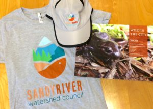 Sandy River Watershed Council logo t-shirt, hat, and calendar