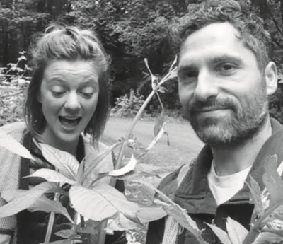 two people with plant
