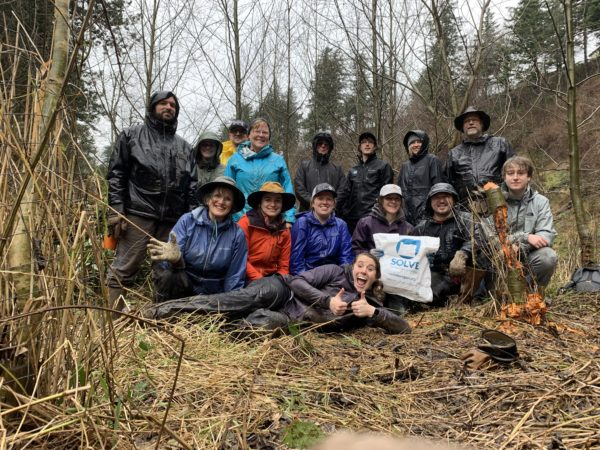 Volunteers pose after removing invasive blackerry